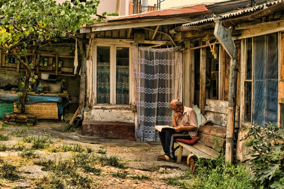 Old man in garden reading